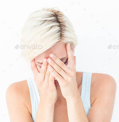 Stressed woman with rubbing her head