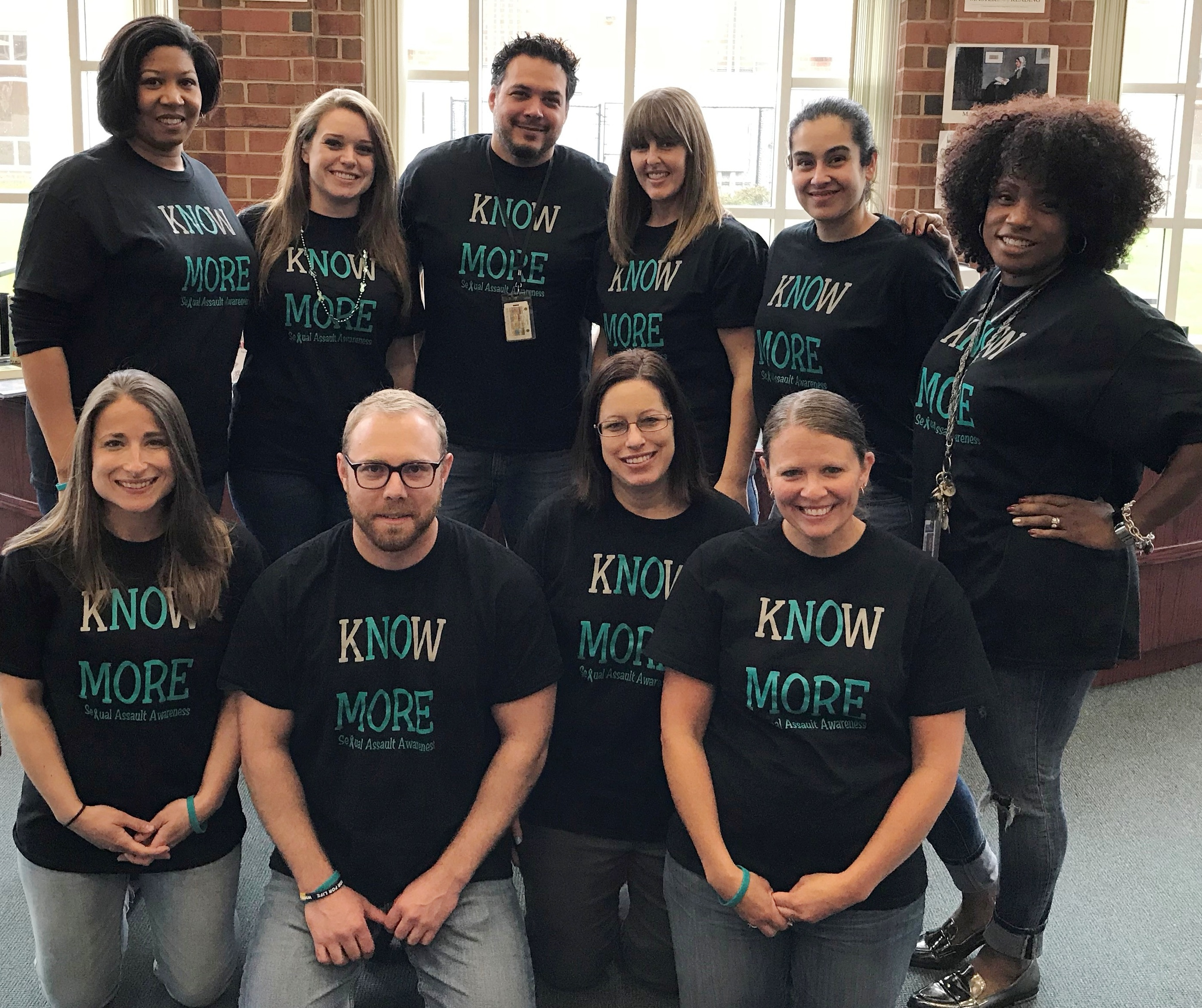 "Photo of Franklin High School staff in ""Know More"" T-shirts"