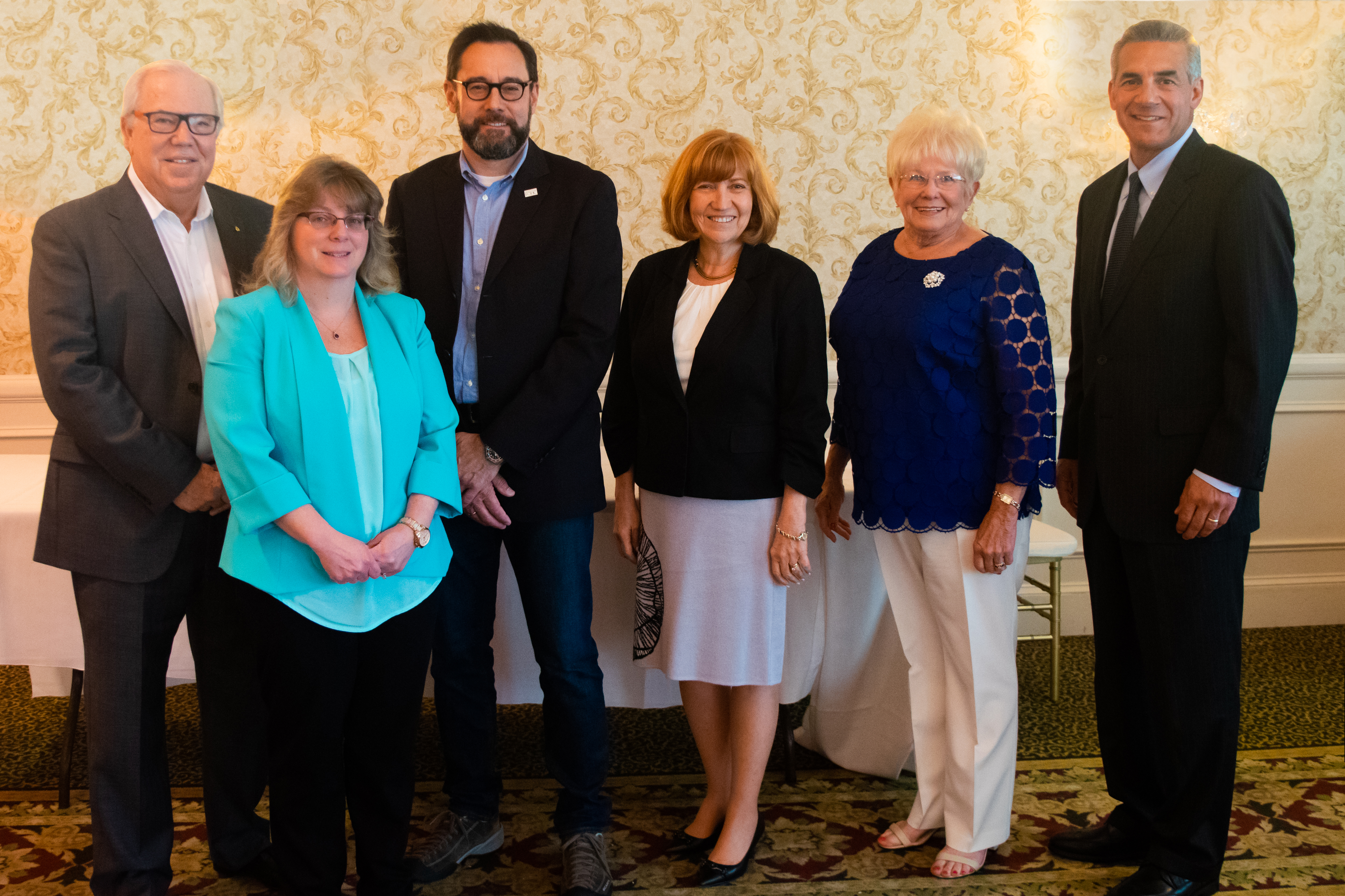 Photo staff, keynote speaker and honorees at Volunteer Appreciation event
