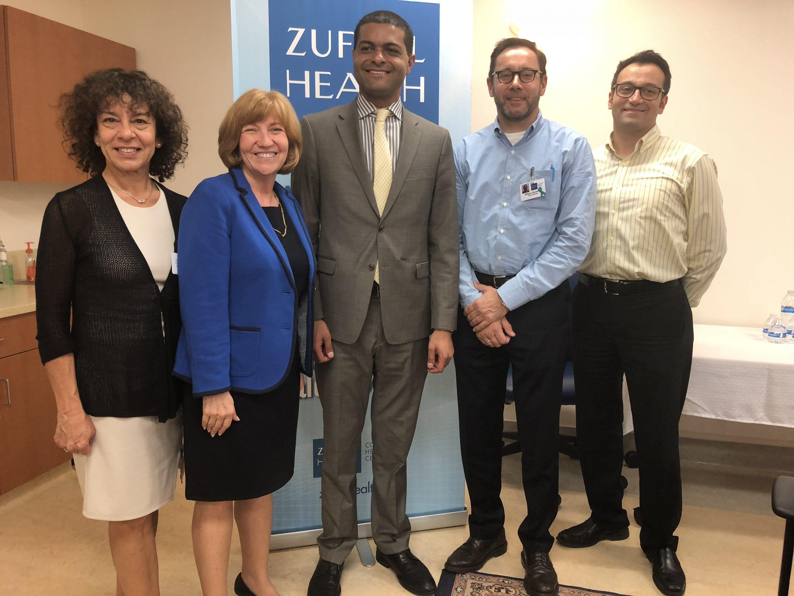 Photo of New Jersey's Health Commissioner posing with Zufall staff and Board