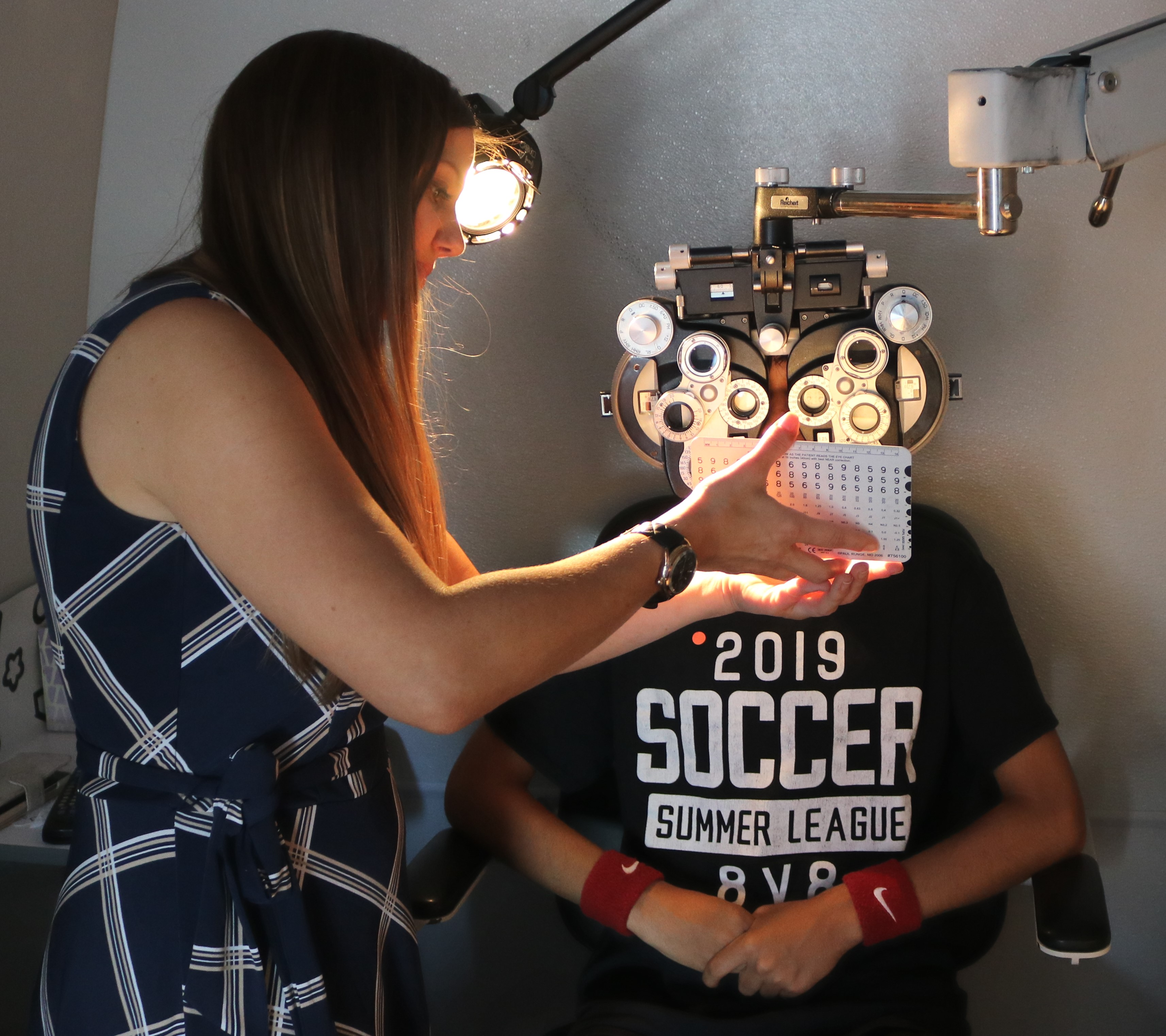 Photo of a young boy receiving a vision acuity test