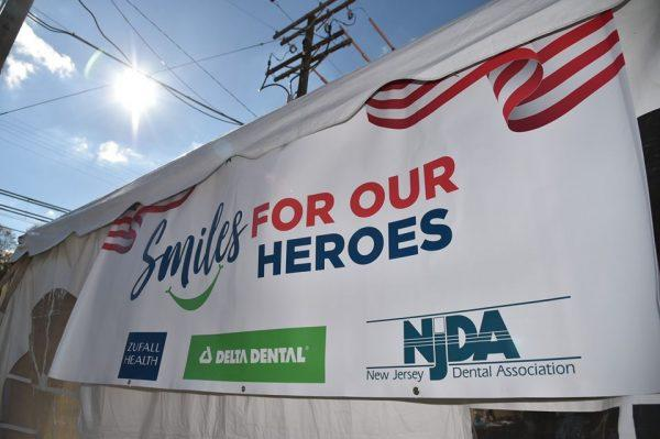 "Banner that says ""Smiles for Our Heroes"""